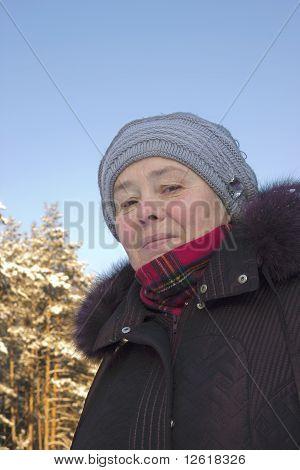 The Elderly Woman On Stroll