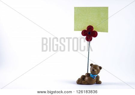 Teddy bear with a blank sign in a white background