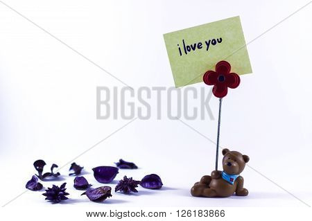 Teddy bear with a I Love You sign in a white background