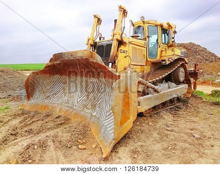 PILSEN CZECH REPUBLIC - APRIL 11, 2016: The Cat D9T Dozer is a highly versatile machine flexible enough to be used in heavy construction, quarries, landfills, forestry, and mine sites.