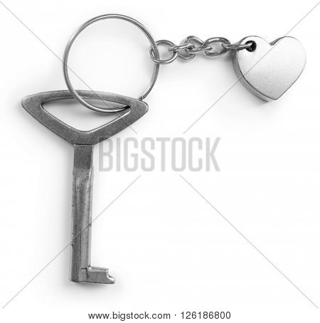 Key with heart trinket, isolated on white