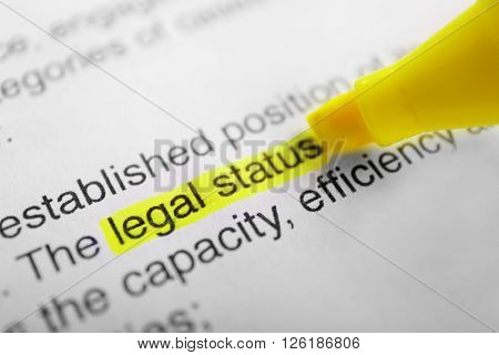 Words Legal status highlighted with a yellow marker