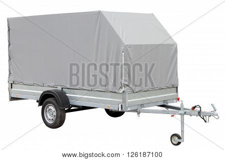 Tarpaulin car trailer isolated on white background.