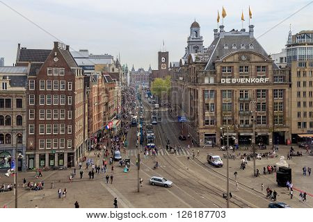 Amsterdam, Netherlands - May 7: This is the central Dam Square and the city's main street Damrak with the train station Amsterdam Central May 7, 2013 in Amsterdam, Netherlands.