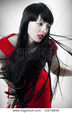Fashion Portrait Of Woman With Flying Hair