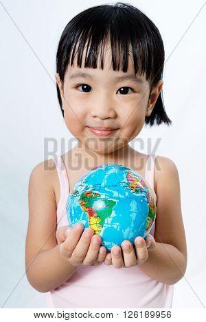 Asian Little Chinese Girl Holding A World Globe