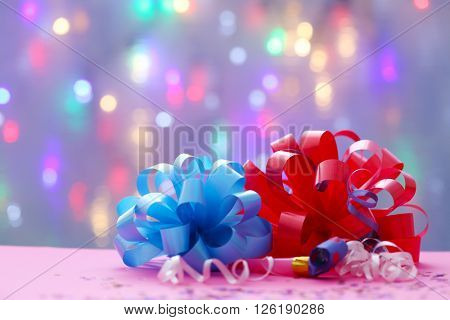 Two party bows on blurred garland background