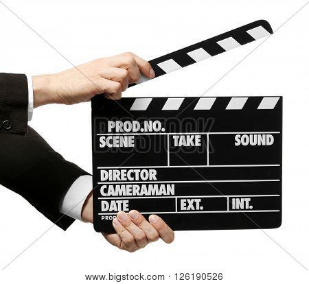 Male hands holding a movie clapperboard, on white background