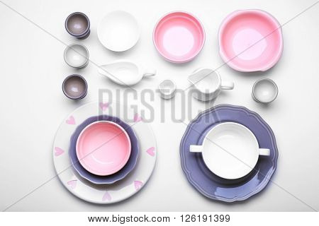 Empty colorful dishes on white background.