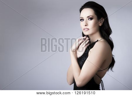 Studio Portrait Of Young Beautiful Brunette Woman In Black Lace Dress