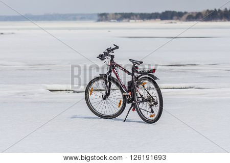 Berdsk Novosibirsk Oblast Siberia Ob River Russia - April 17 2016: mountain bike company Giant ice of the Siberian river Ob