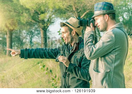 wildlife tourists with binocular and digital camera in a natural park destination bird-watching