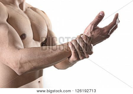 young man with strong muscle body holding with hand his damaged wrist suffering pain in sport injury and health care concept isolated on white background