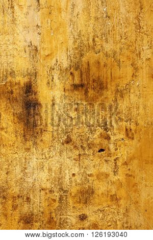 Grunge background with texture old stucco of ochre color