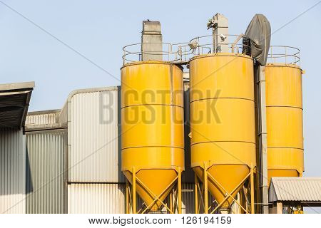 Silos metal structures yellow three for factory raw product material mixing storage.
