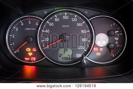 Modern car illuminated dashboard closeup, dashboard lighting