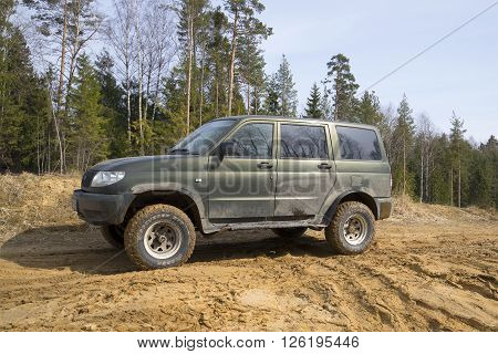 LENINGRAD REGION, RUSSIA - APRIL 11, 2014: Russian UAZ-Patriot on a dirt country road after jeeping, spring day
