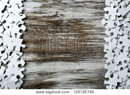 Puzzles on wooden table