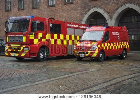COPENHAGEN, DENMARK - NOVEMBER 01, 2014: Two car municipal fire service. Fire service cars Denmark prepared to travel