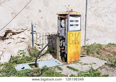 Distributor or gas pump abandoned. Isolated old and rusty in a war zone a symbol of power the concept of abandonment. Abstract pollution. Old gas station. In war zones.