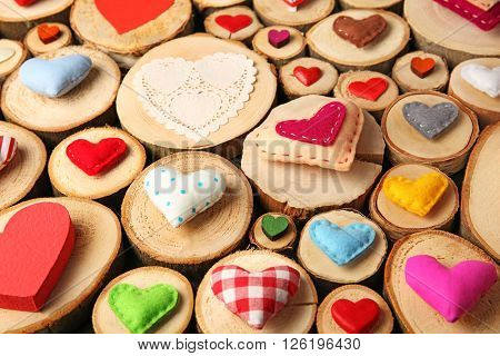 Valentine's Day concept. Different handmade hearts on wooden stumps background