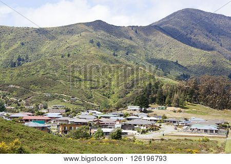 The view of Picton resort town residential district surrounded by mountains (New Zealand).