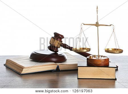 Wooden gavel with justice scales and books on white background