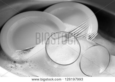 Dishes in kitchen sink closeup