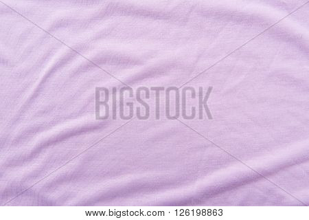 Close up of beautiful wrinkle purple fabric texture.