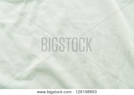 Close up of beautiful wrinkle light green fabric texture.