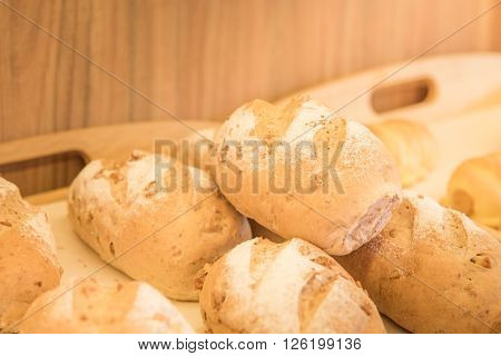 Close up of fresh bake bread on wooden tray in tokyo bakery shop japan.