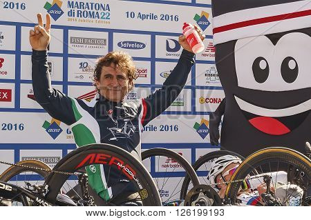 Rome Italy - April 10 2016: Alex Zanardi is the winner of the hand bike race of Rome Marathon 2016. Zanardi celebrates the victory and the record time of the race.