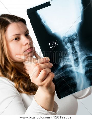 woman looks uncertain sheets x -rays of the cervical