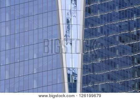 A zoomed in image of the glass windows of the exterior of the Freedom Tower in Manhattan in New York City.