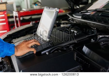 Mechanic Using Diagnostic Machine Tools Ready To Be Used With Car