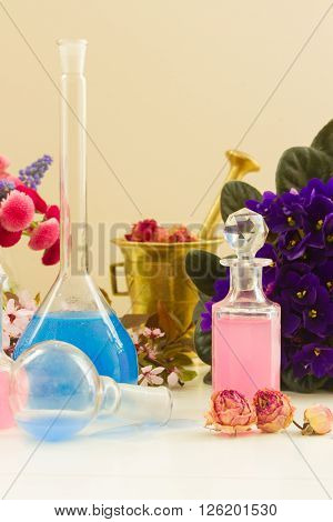 Dry flowers and vials  of tincture or oil, aromatherapy concept