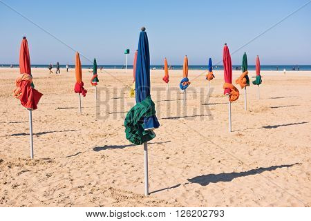 The famous colorful parasols on Deauville beach Normandy Northern France