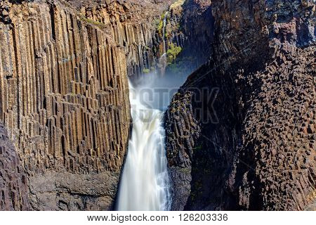 The Litlanesfoss waterfall in Iceland with its basaltic columns