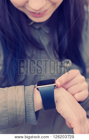Young Girl Looking At Her Smart Watch