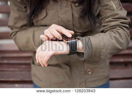 Hands Of A Girl Using Her Smart Watch