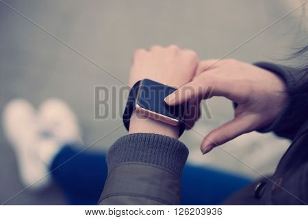 Woman Using Her Smart Watch On Hand