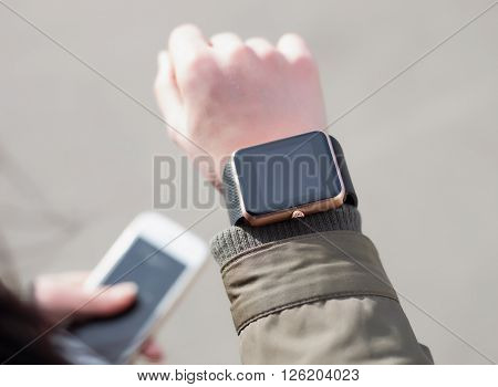Close Up Of Female Hands With Smart Watch And Phone