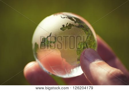Macro Photo Of Glass Globe In Human Hand
