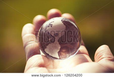 Macro Photo Of Glass Globe In Human Hand