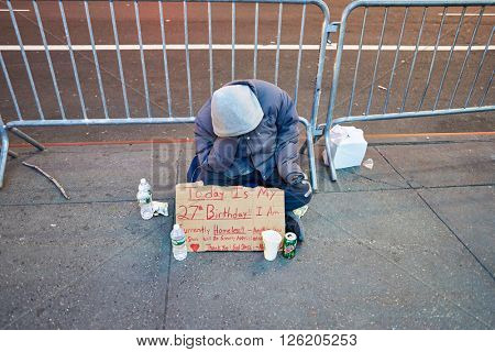 NEW YORK - CIRCA MARCH 2016: homeless sit on street in New York City. The City of New York, often called New York City or simply New York, is the most populous city in the United States