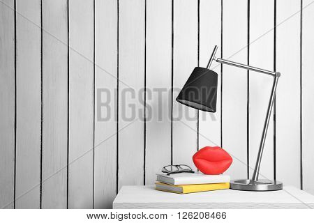 Lamp and home decor on the locker on wall background