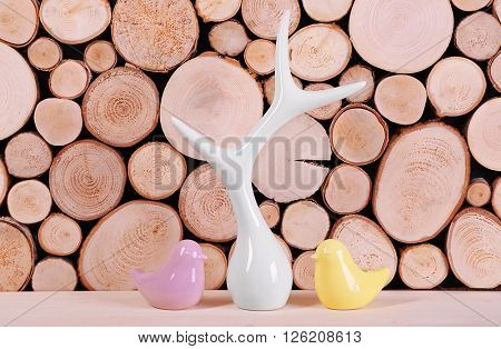 Decorative figurines on wooden background