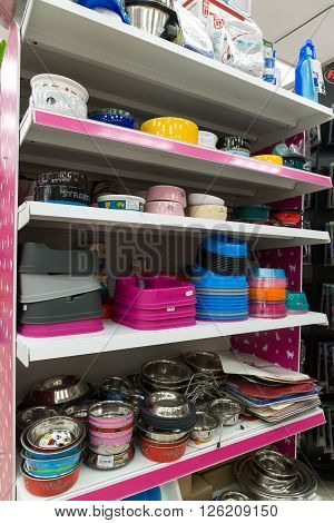 Moscow, Russia - April 16.2016. Bowls and plates in a  Four paws pet store