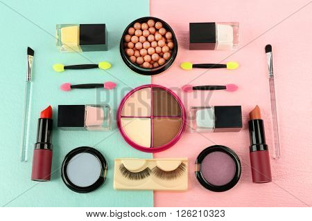 Makeup set with false eyelashes, brushes and cosmetics on bright background