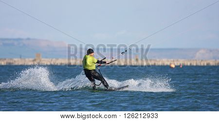 Kitesurfer riding his board in Portland Harbour ** Note: Soft Focus at 100%, best at smaller sizes